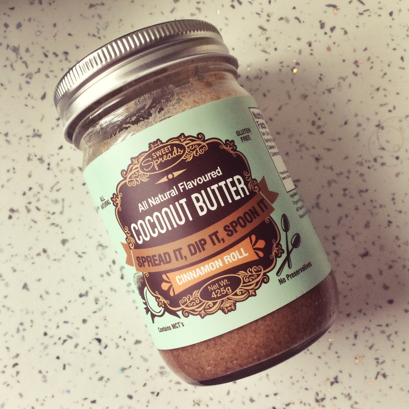 Head to Tone Blog: Jar of Sweet Spreads Cinnamon Roll Flavoured Coconut Butter Reviewed by Nom. Image Copyright Naomi Bullivant for Head to Tone Blog